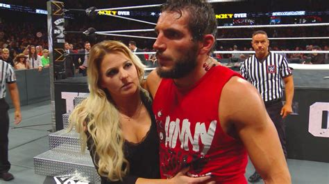 Candice LeRae helps a battered Johnny Gargano from the