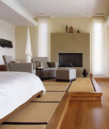 The bed and sitting area share a raised platform carpeted